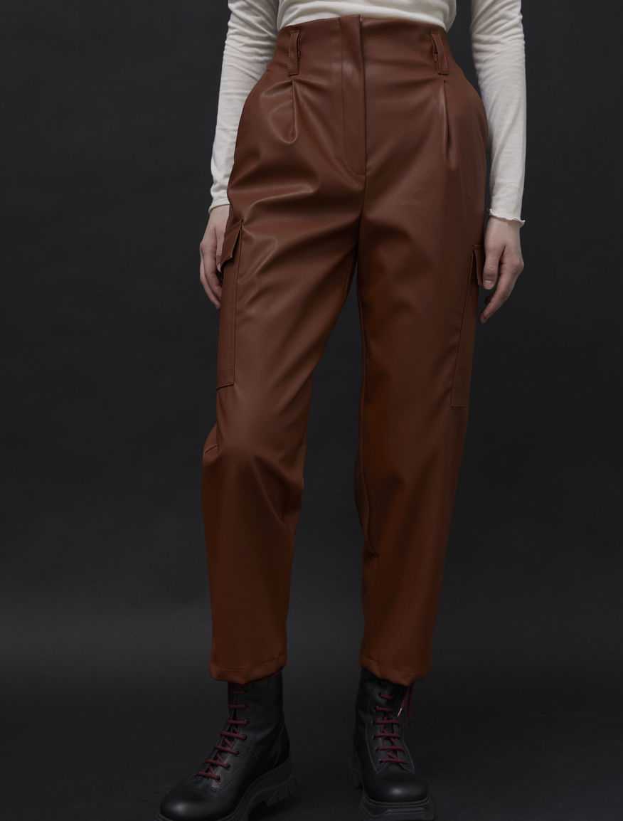 Coated-look trousers